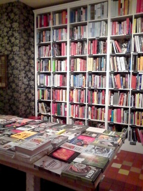 One of four walls covered in food books.